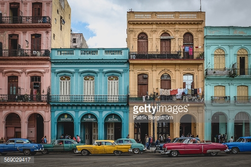 Photo on the streets of old Havana, with a lot nice classical american cars.
